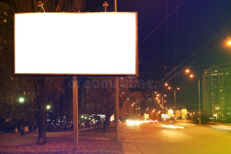 Blank advertising board on city street royalty free stock images