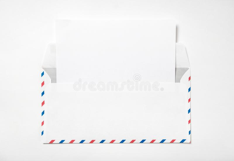 Open envelope with a sheet of paper. royalty free stock images
