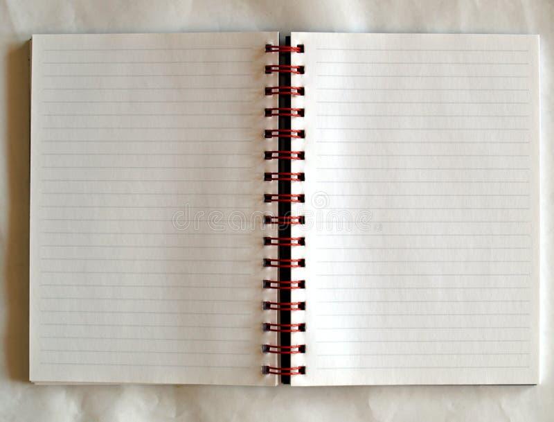 blank anteckningsboksida arkivfoto