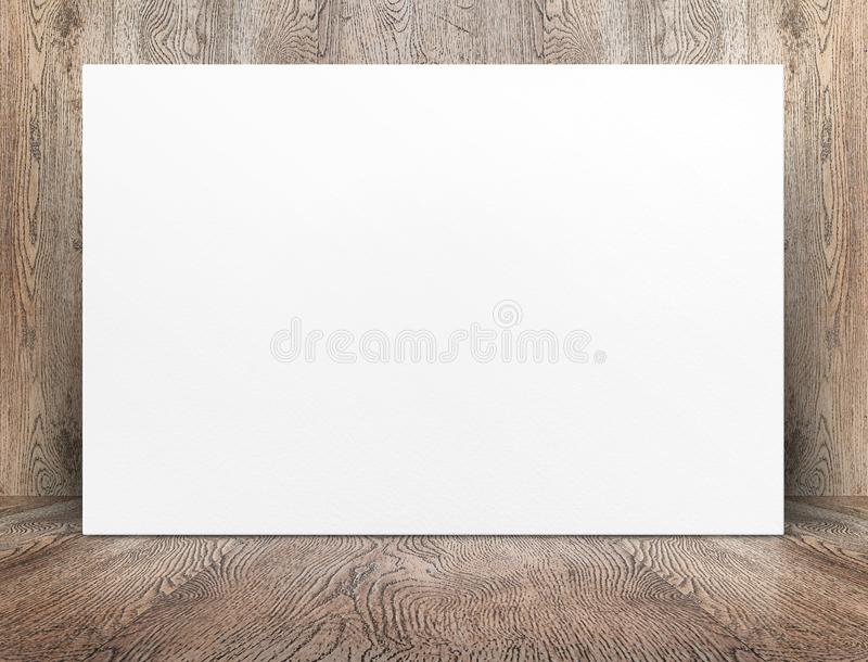 Blank banner white paper poster leaning at wood wall on wooden f. Loor in perspective room,Business mock up presentation.Template display of design or content stock images