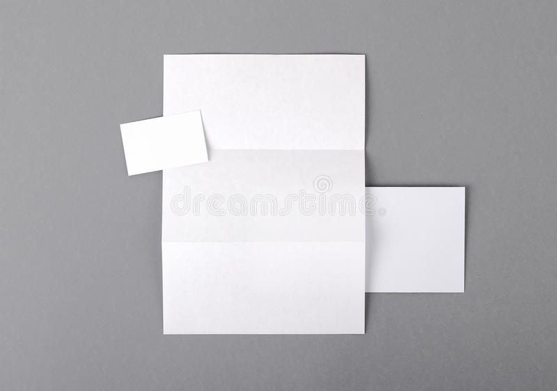 Blank basic stationery. Letterhead folded, business card, envelope. stock photo