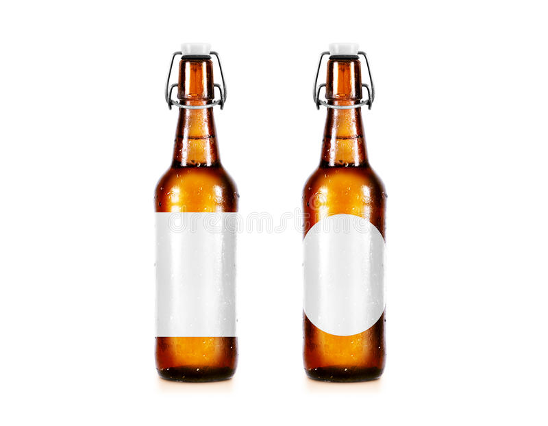 Blank beer bottle mockup without label, stand . Clear alcohol beverage botle mock up with clipping path. Cold wet beer flask template front view. Brewery stock photography