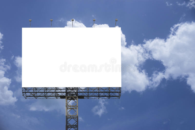 Blank big billboard against blue sky background,for your advertising,put your own text here,isolate white on board stock photo