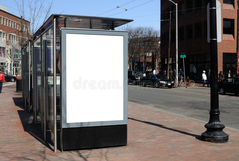 Blank billboard at bus stop stock image