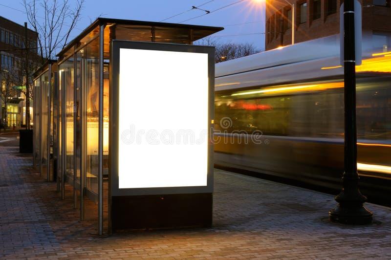 Blank billboard at bus stop stock photos