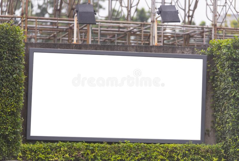 Blank billboard in bush frame with spot light royalty free stock photography