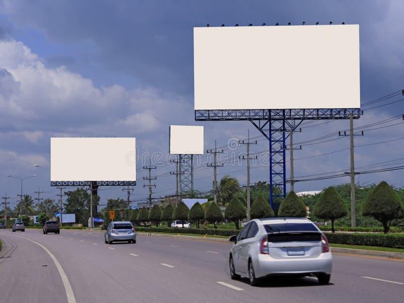 Blank billboard on highway stock photos