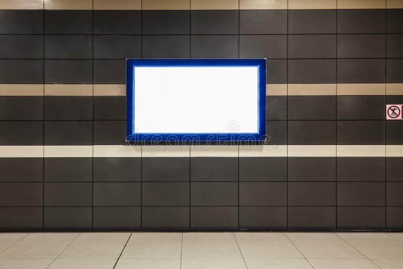 Blank billboard in metro station / big horizontal poster on metro station royalty free stock images