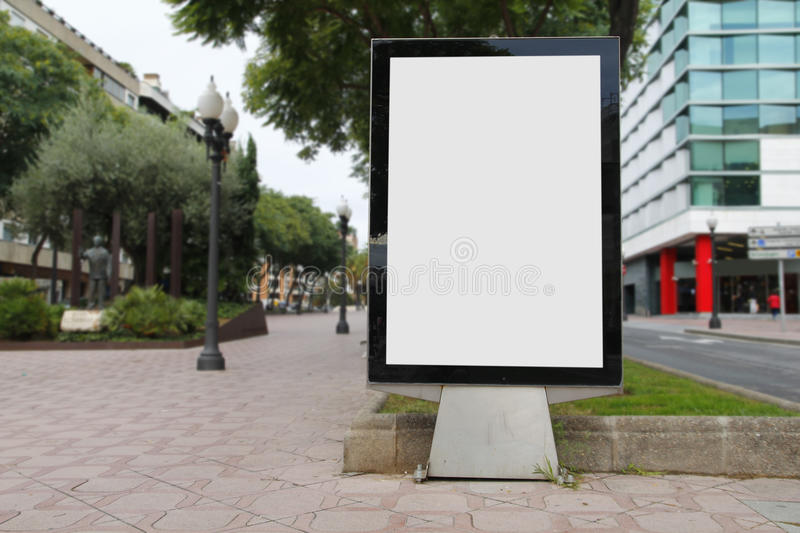 Blank billboard mockup in the street. With blurred background stock photo