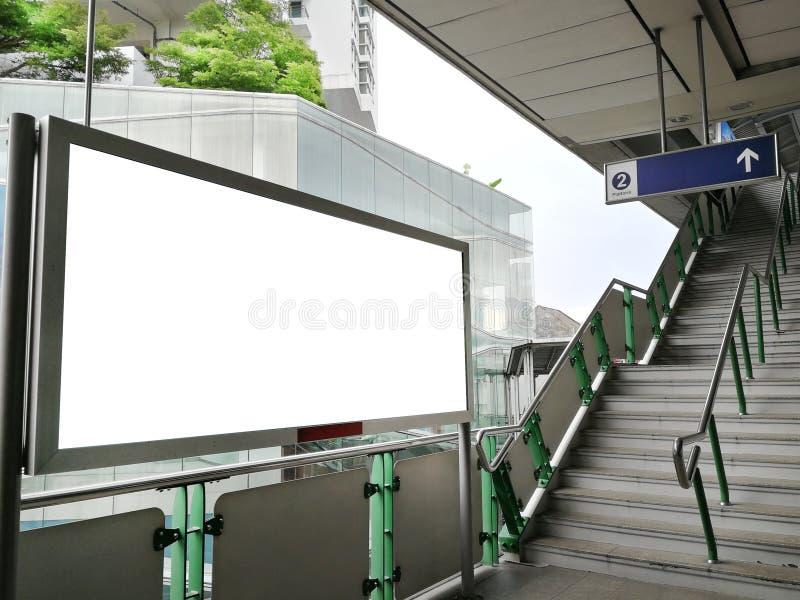 Blank billboard outdoors, public information board on Skytrain station - Advertising concept stock photos