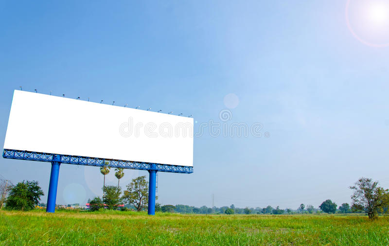 Blank billboard ready for new advertisement on meadow royalty free stock photography