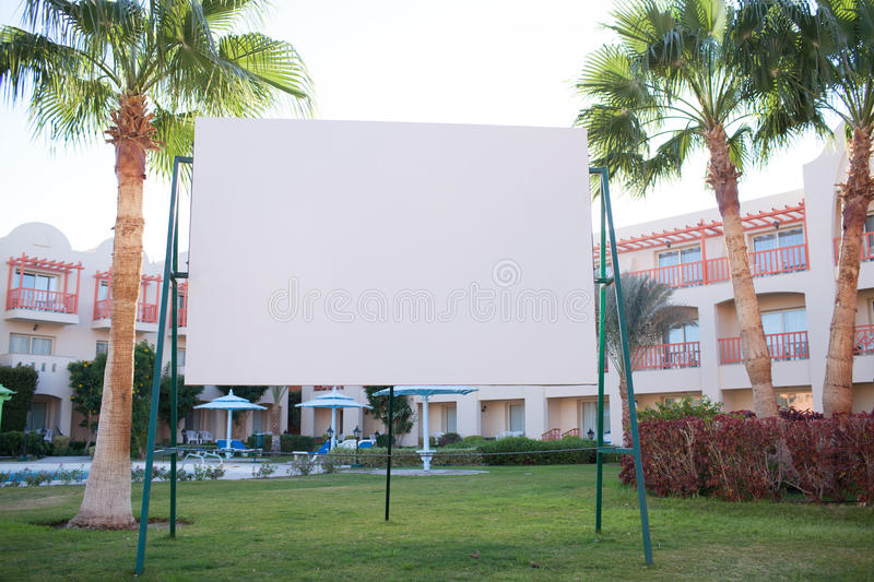 Blank billboard with tropical palm trees stock images