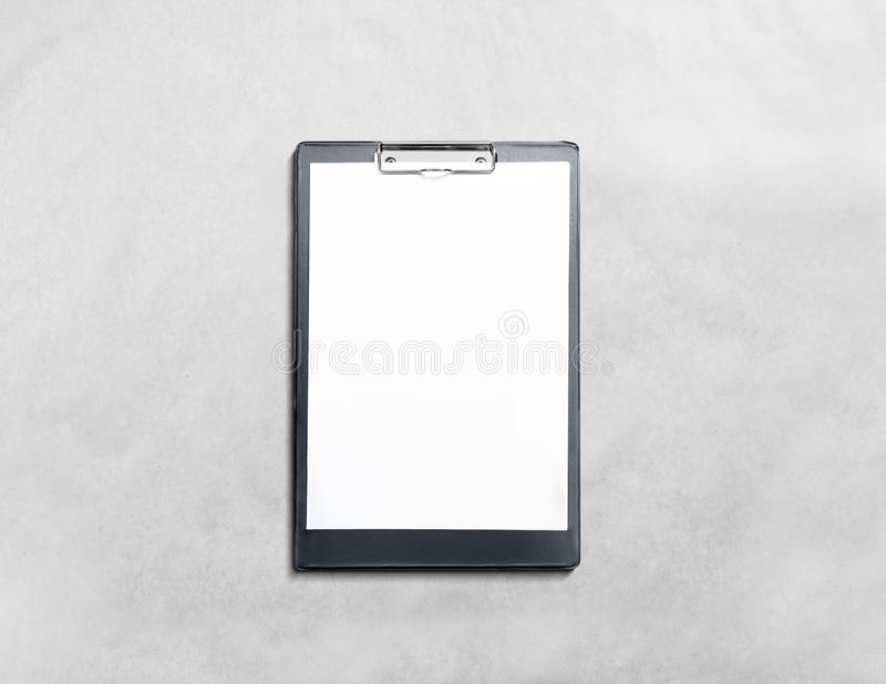 Blank black clipboard with white pages mockup. Isolated in textured background. Empty document holder mock up lying on grey desk. Clear clip board organizer royalty free stock photography