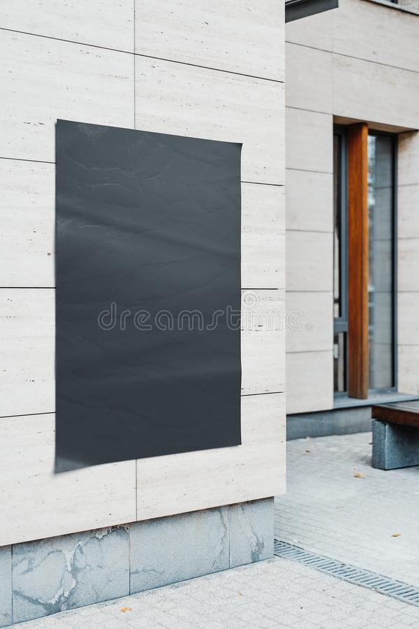 Blank black outdoor banner or poster on modern wall. 3d rendering. Blank black outdoor banner or poster on bright modern building wall, mock up. 3d rendering stock photography