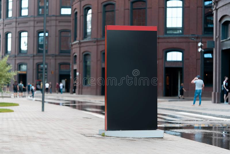 Blank black outdoor banner stand next to modern building. 3d rendering. stock illustration
