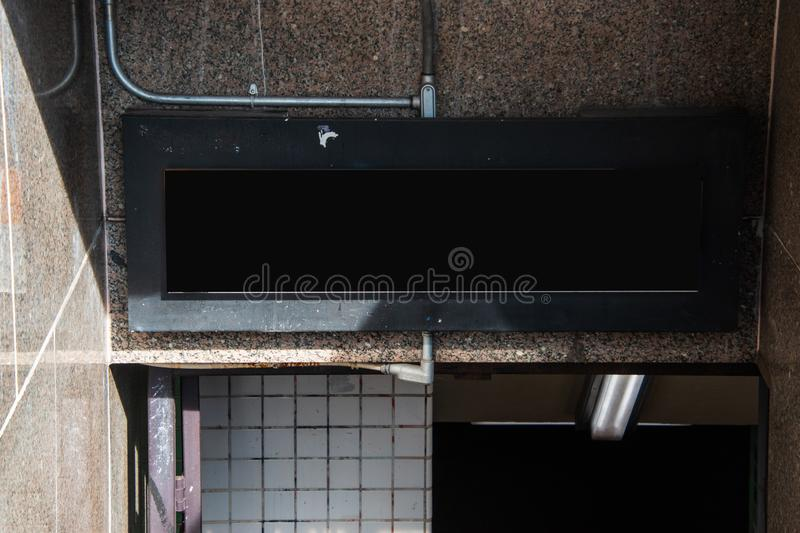 Blank black sign over entrance to underground subway train station. Blank black sign over entrance to underground subway train station royalty free stock photography