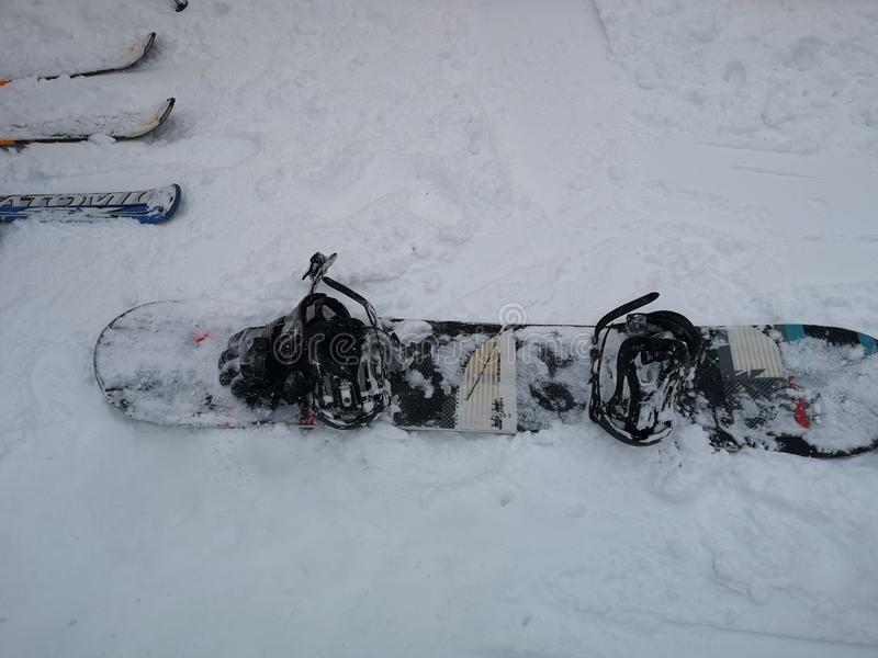 Blank black snowboard design mockup, front and snowboarding sport equipment stock photos
