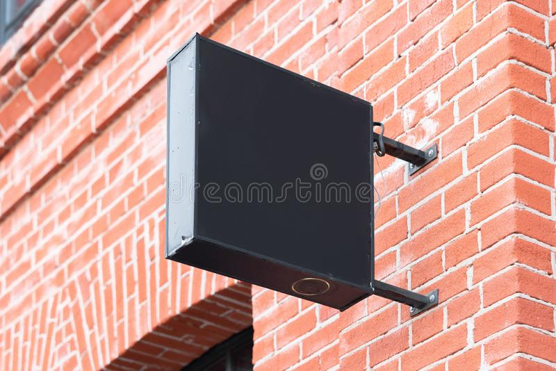 Blank black square store signboard Mockup. Empty shop Street sign, signage on the wall. , 3d rendering. Blank black square store signboard Mockup. Empty shop royalty free illustration