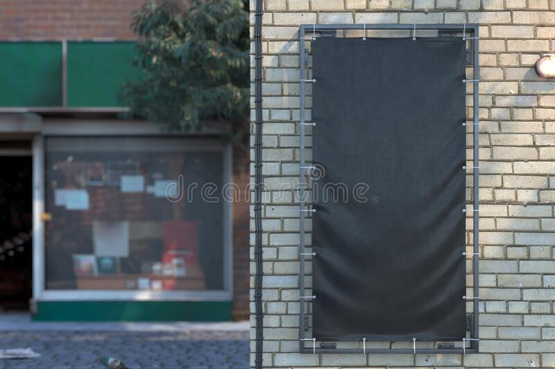 Blank Black Vertical Outdoor Vinyl Textile Banner at Bright Brick Wall. Copy Space. Empty Space. royalty free stock image