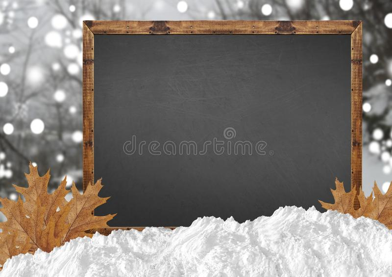 Blank blackboard with blurr forest and snow and leaves. Close stock image