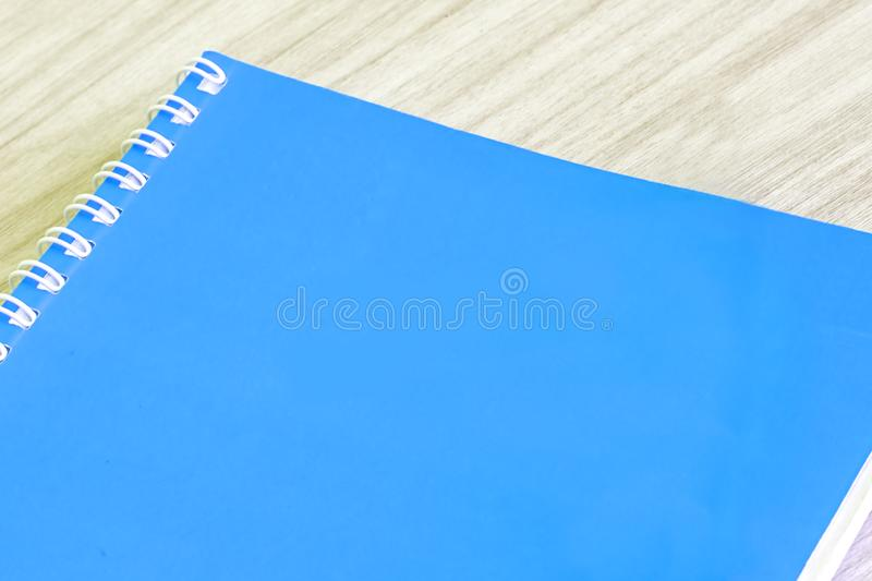 Blank blue book empty cover book spiral stationery school supplies for education business idea book cover design note pad memo on. Wooden background stock images