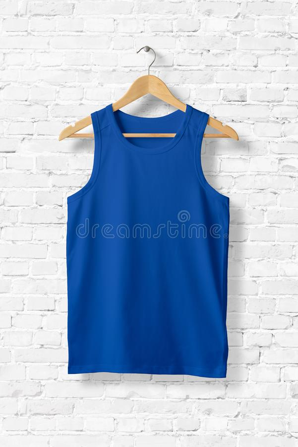 Blank Blue Tank Top Mock-up hanging on white wall. royalty free illustration