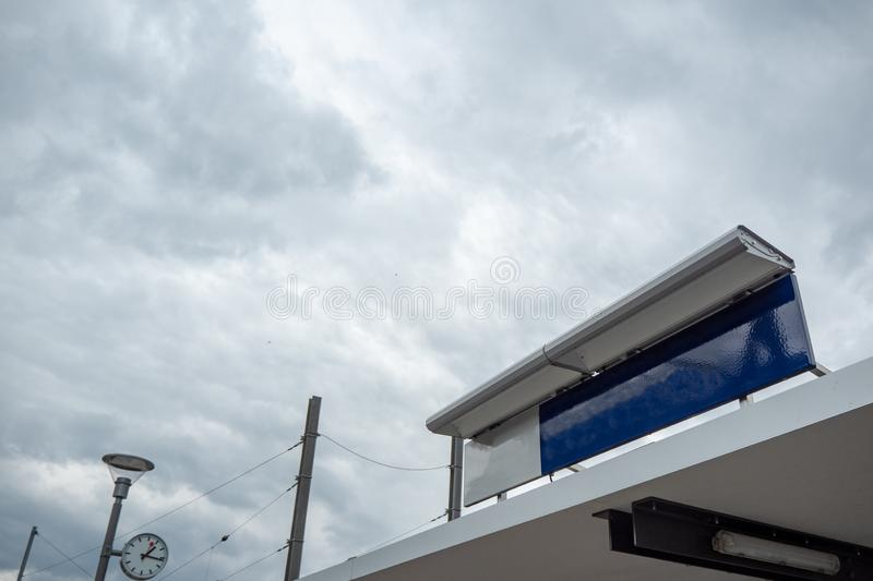 Blank blue and white sign on cloudy sky background stock photos