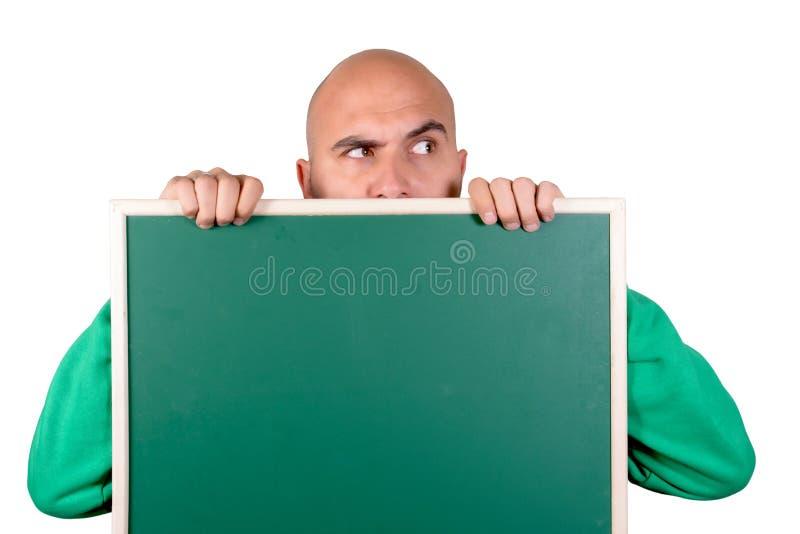 Blank board. Bald man holding blank chalk board stock photos