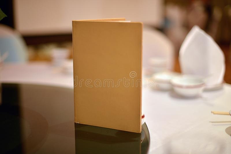 Blank book cover on dining table in wedding ceremony.  royalty free stock photo