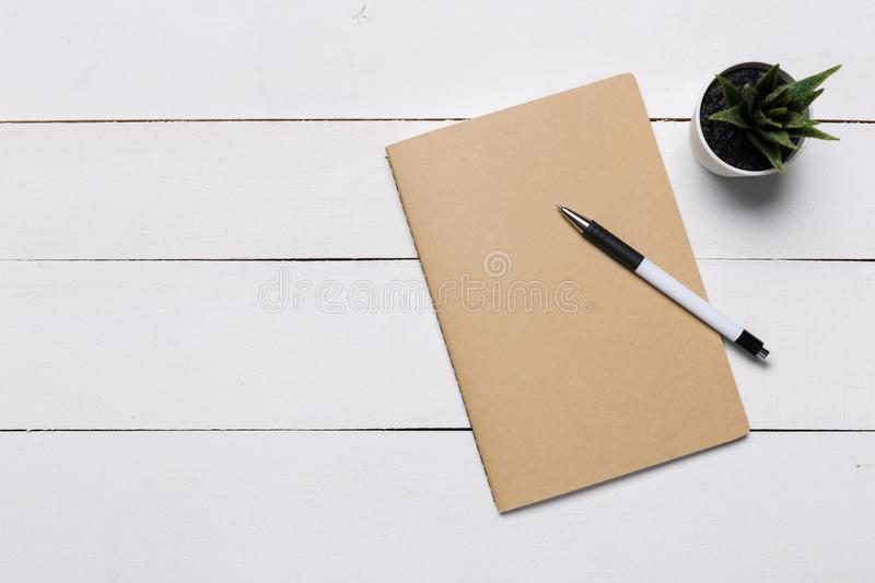 Blank book cover template with page in front side standing on white wood background. Flat lay stock photo