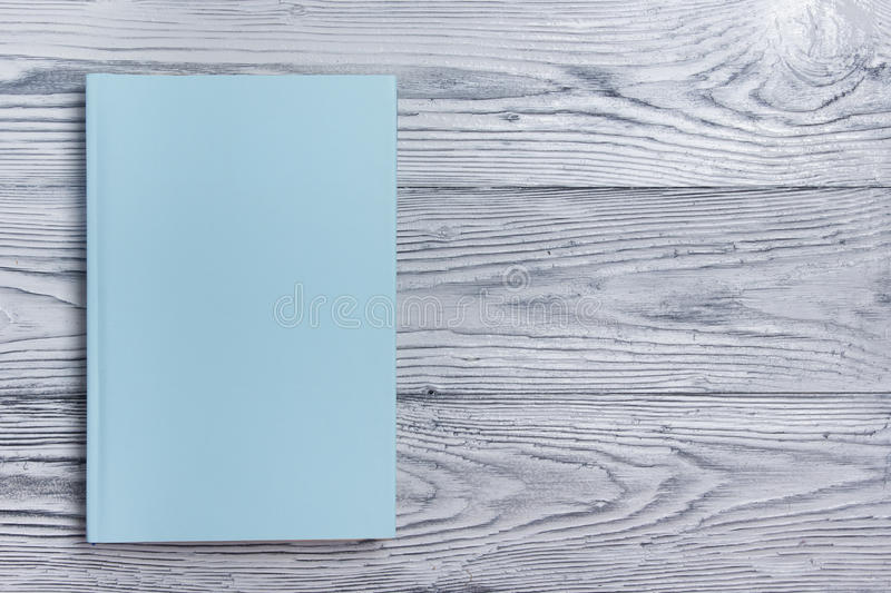 Blank Book Cover Background ~ Blank book cover on textured wood background copy space