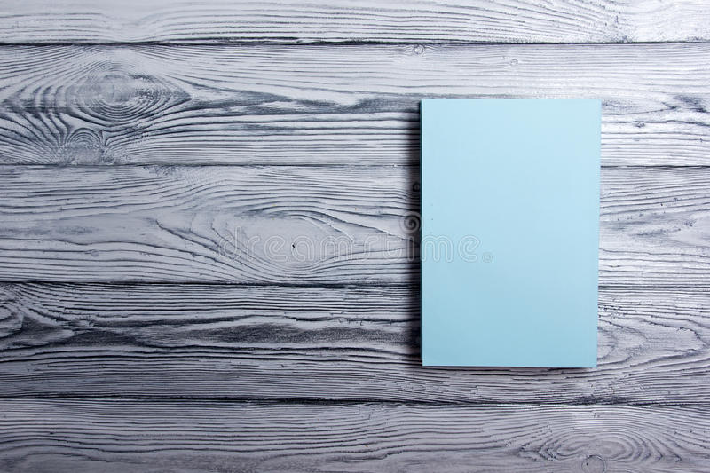 Blank book cover on textured wood background. Copy space royalty free stock photography