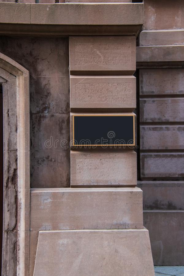 Blank brass plaque on stone building wall. Blank brass plaque on stone building wall royalty free stock photography