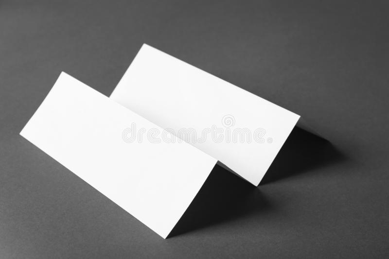 Blank brochure on dark grey background. Mock up for design royalty free stock photo