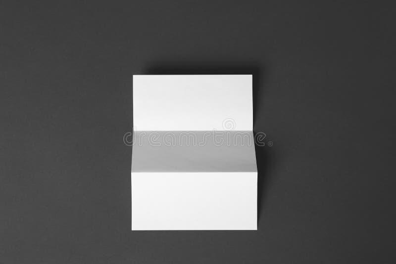 Blank brochure on dark grey background. Mock up for design. Blank brochure on dark grey background, top view. Mock up for design stock images