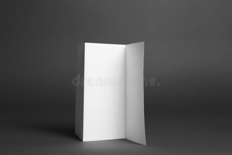 Blank brochure on grey background. Mock up for design. Blank brochure on dark grey background. Mock up for design stock image