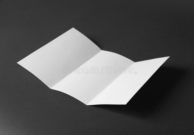 Blank brochure on grey background. Mock up for design. Blank brochure on dark grey background. Mock up for design royalty free stock image