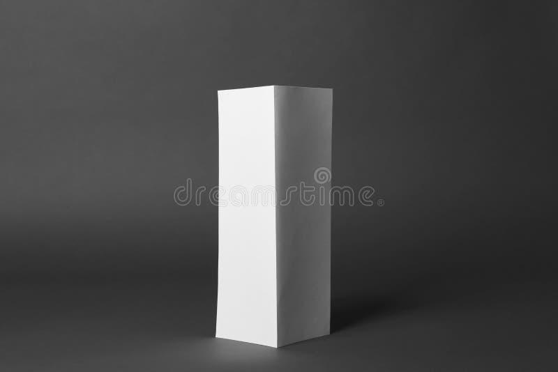 Blank brochure on grey background. Mock up for design. Blank brochure on dark grey background. Mock up for design stock images