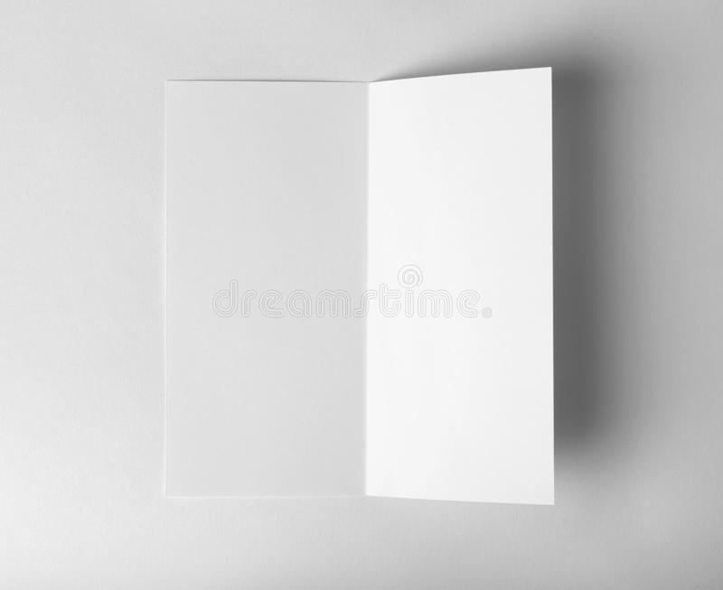 Blank brochure mock up on white background. Top view royalty free stock image