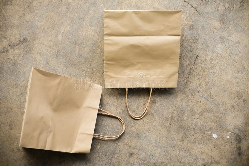Blank brown paper bag. Flat lay. Template for branding identity stock images