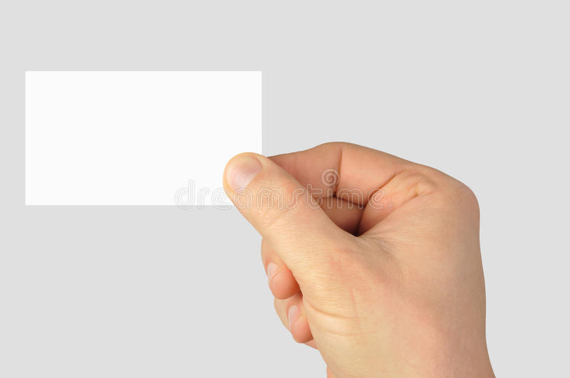 Blank Business Card. Hand holding blank business card isolated on grey background royalty free stock photo