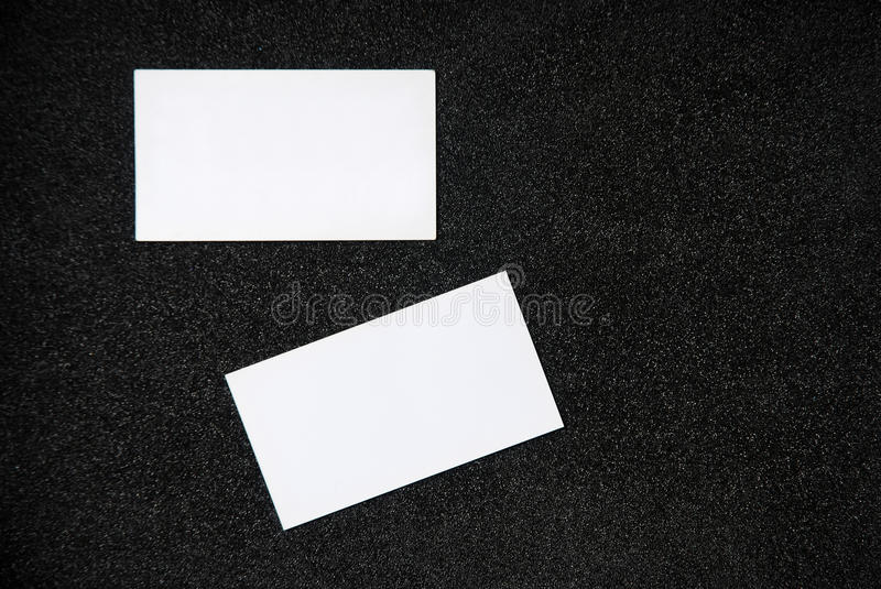 Blank business card. On dark background. Front and back side of card royalty free stock image