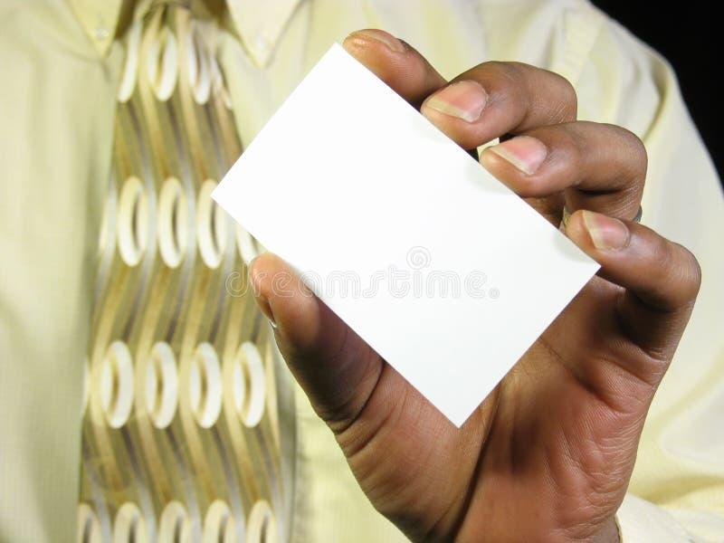Blank business card. African american man holding a blank business card. add your own text stock photos