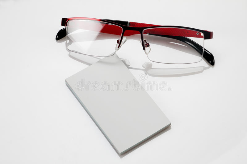 Blank business card with eyeglasses for mockup. Blank business card with red frame eyeglasses for mockup royalty free stock image