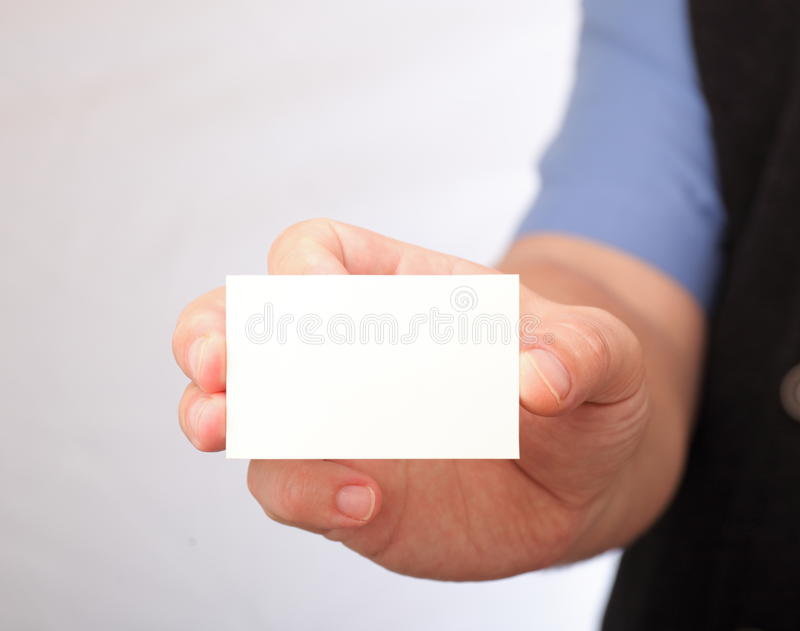 Blank Business Card In A Hand Royalty Free Stock Image