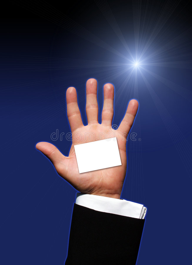 Blank business card in hand. Photo of a Blank business card in hand stock images