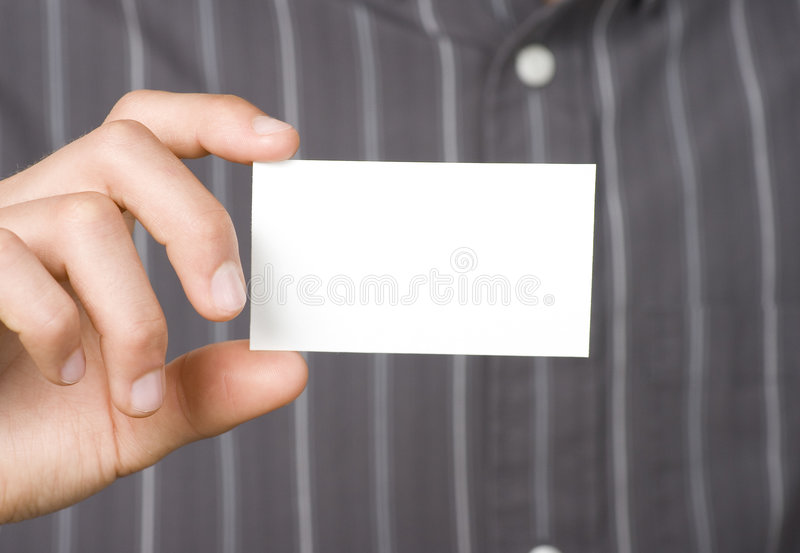 Blank Business Card in Hand. Blank business card held in hand by business person royalty free stock image