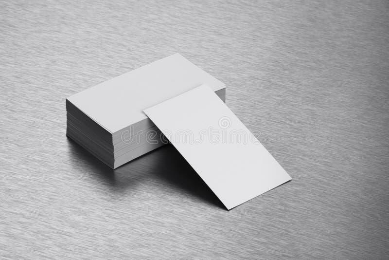 Blank Business Card Mockup on Brushed Steel Background stock photo