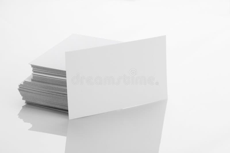 Blank Business Card Mockup on White Reflective Background. Blank Business Card Mockup on Reflective Background stock photography
