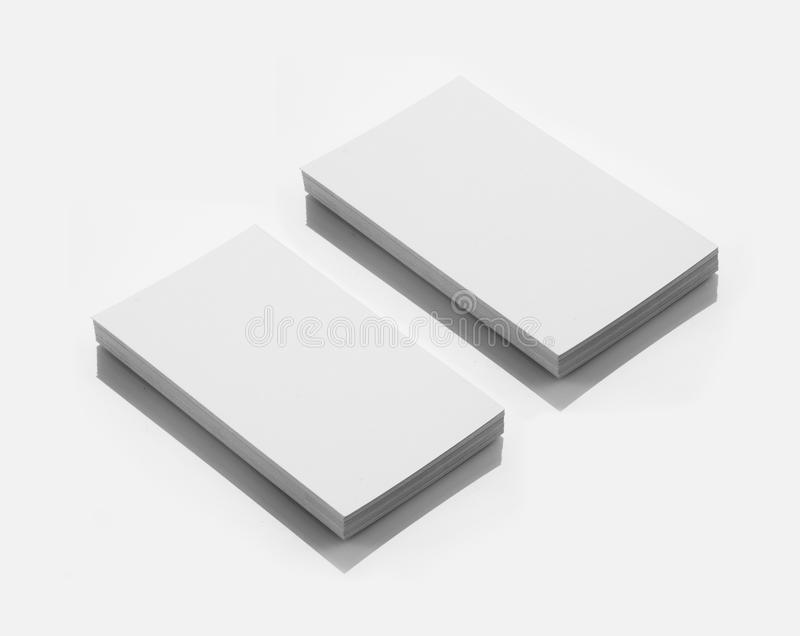 Blank Business Card Mockup on White Reflective Background. Blank Business Card Mockup on White Background stock images